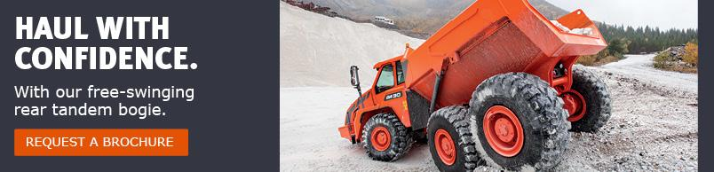 A Doosan DA30 articulated dump truck rolling through uneven terrain.