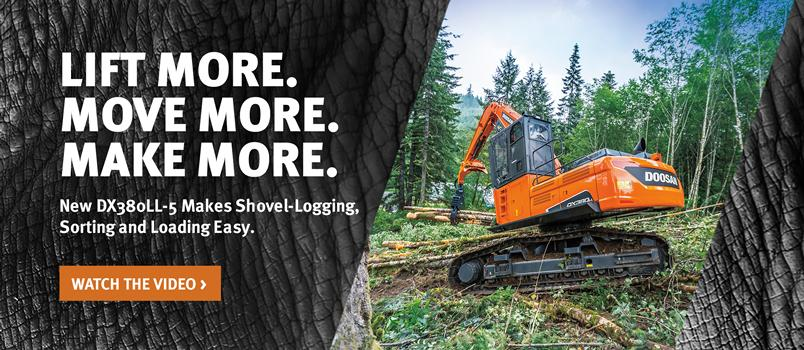 DX380LL-5 log loader picks up a load of logs.