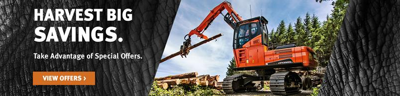 Doosan DX225LL-5 Log Loader moving timber with the log grapple attachment.