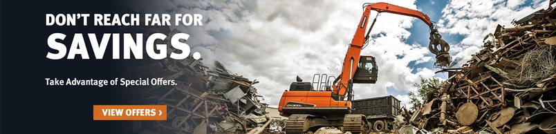 Doosan DX300MH-5 Material Handler moves scrap and refuse.