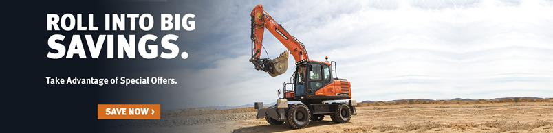 Doosan DX140W-5 wheel excavator moves across a jobsite.