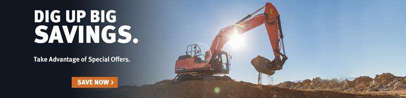 Doosan DX190W-5 wheel excavator digs with a bucket attachment.