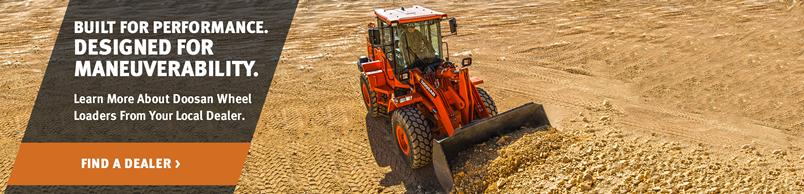 Doosan DL200-5 Wheel Loader moves a pile of soil with a bucket attachment.