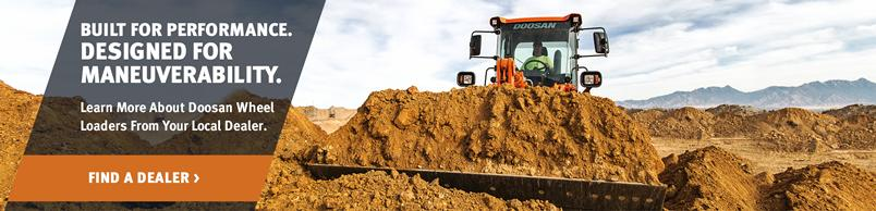 Doosan DL250-5 Wheel Loader moves a pile of soil.