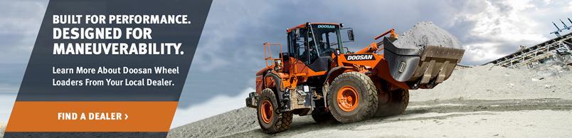 Doosan DL350-5 Wheel Loader hauls soil on a construction jobsite.