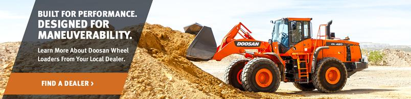 Doosan DL420-5 Wheel Loader dumps a pile of dirt with a bucket attachment.
