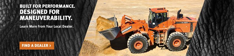 Doosan DL550-5 Wheel Loader hauls a pile of dirt with a bucket attachment.
