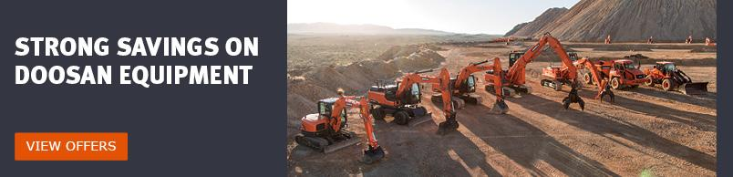 A lineup of Doosan excavators, material handlers, articulated dump truck and wheel loader against the sunlight.
